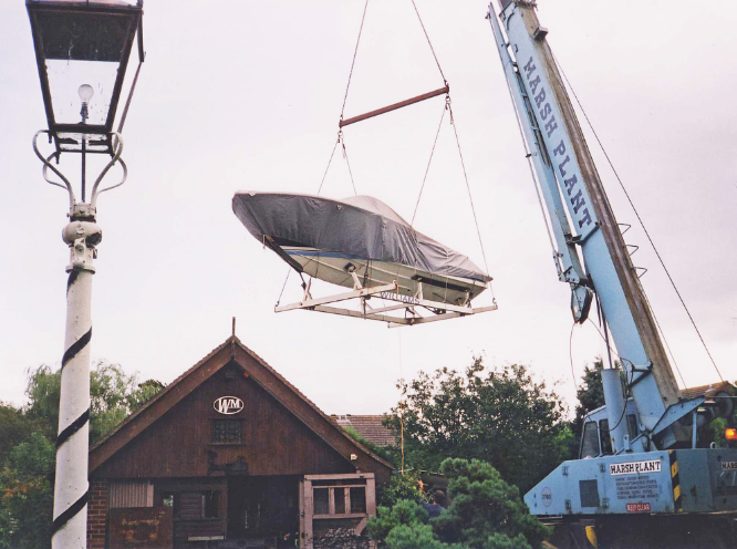 Boat hanging over a house