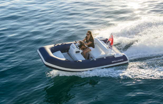 A woman driving a boat