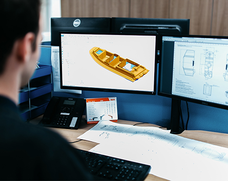 3D model of yellow boat on computer screen